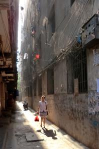 passageway girl & bag--sun & dust